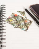 Notepad and mobile phone Stock Photography