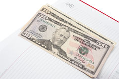 Notepad and money Royalty Free Stock Image