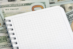 Notepad on money Royalty Free Stock Images