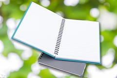 Notepad na Zielonym bokeh Obrazy Stock