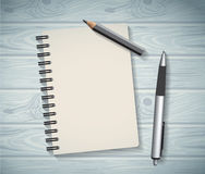 Notepad objects wood background flat design pen and pencil write Royalty Free Stock Photos