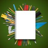 Notepad och pennor arkivfoton