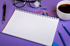 Notepad with office supplies Royalty Free Stock Photos