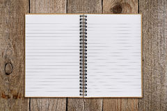 Notepad on old wood Royalty Free Stock Photo