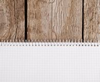 Notepad on old wooden background Stock Image