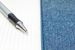 Notepad open and pen. Stock Photos