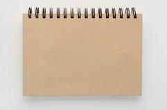 Notepad på vit bakgrund jpg Arkivfoto