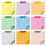 Notepad with page curl set. Notepad set in assorted colors with page curled up, clip at top of pad and ample copy space for text stock illustration