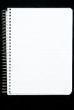 Notepad page isolated on black Royalty Free Stock Photo