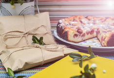 Notepad, paper envelope and piece of pie on the colorful tablecloth Royalty Free Stock Photography