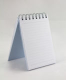 Notepad paper. An image of a lined notepad with spiral binding royalty free stock image