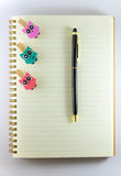Notepad, paperclip and pen  on white background Royalty Free Stock Photos