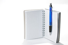 Notepad and a pen. A notepad and a pen isolated on a white background Stock Photo