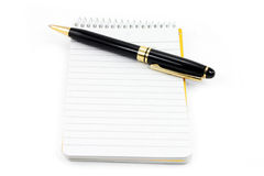 Notepad and pen Royalty Free Stock Images