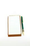 Notepad with pen. Notepad open with pen beside it isolated on white Stock Photography