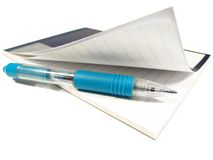 Notepad and pen. Isolated close-up on the background Royalty Free Stock Image