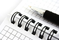 Notepad and pen. Notepad and pen on a white background Royalty Free Stock Image