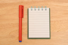 Notepad and pen Stock Photography