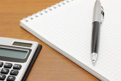 Notepad with pen and calculator Royalty Free Stock Photography