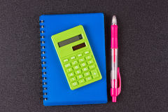 Notepad, pen, calculator. On the blacke table Stock Photo