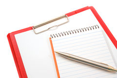 Notepad, Pen and Clipboard. On white background Stock Images