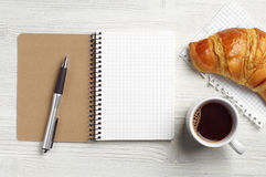 Notepad, pen, coffee and croissant Stock Photography