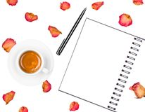 Notepad, pen, coffee cup and dried roses isolated on white background. Flat lay. Top view Stock Photos