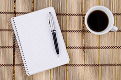 Notepad, pen and  coffee mug. Royalty Free Stock Images