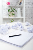 notepad with a pen, and crumpled paper Royalty Free Stock Image