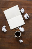 Notepad, pen, crumpled paper and cup of coffee Stock Image