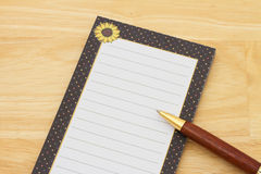 A notepad and pen on a desk with copy-space stock photos