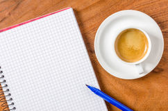 Notepad with pen and espresso Stock Photography