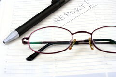 Notepad pen with eyeglasses Stock Images