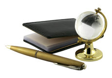 Notepad, pen and glass globe. Stock Photo