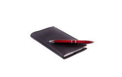 Notepad and pen. Notepad with pen isolated on white background Stock Photography