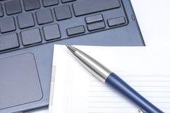Notepad and pen on keyboard Stock Photography