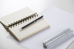 Notepad, pen and markers Stock Photos
