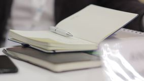The Notepad the Pen. The Notepad and pen on the table conference meeting close up stock video footage
