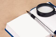 Notepad and pen at paper Royalty Free Stock Images