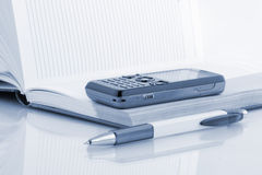 Notepad pen and phone for contact. Stock Photography