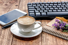 Notepad, pen,phone, envelope, keyboard and coffee cup on an wood Royalty Free Stock Photo