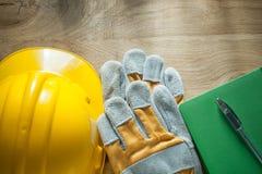 Notepad pen protective gloves building helmet Stock Image