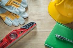 Notepad pen protective gloves building helmet construction level Stock Image