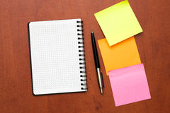 Notepad with pen and reminder notes Royalty Free Stock Photo