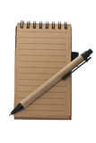 Notepad and pen in retro style. Stock Photos