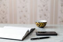 Notepad pen smartphone Royalty Free Stock Images