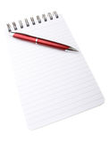 Notepad and pen. Spiral bound notepad with red ball point pen  on white background Royalty Free Stock Images