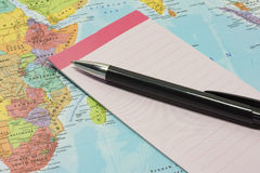Notepad and pen on top of map. Point of view perspective of small notepad and pen on top of paper map of the Indian Ocean and Africa stock photos