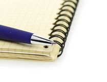 Notepad and pen  on white background Royalty Free Stock Images
