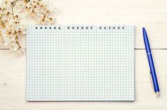 Notepad and pen with wild spring flowers royalty free stock image